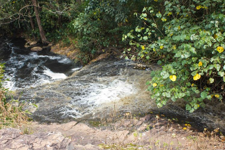 the river, blacked by pollution, that leads to Griffins falls